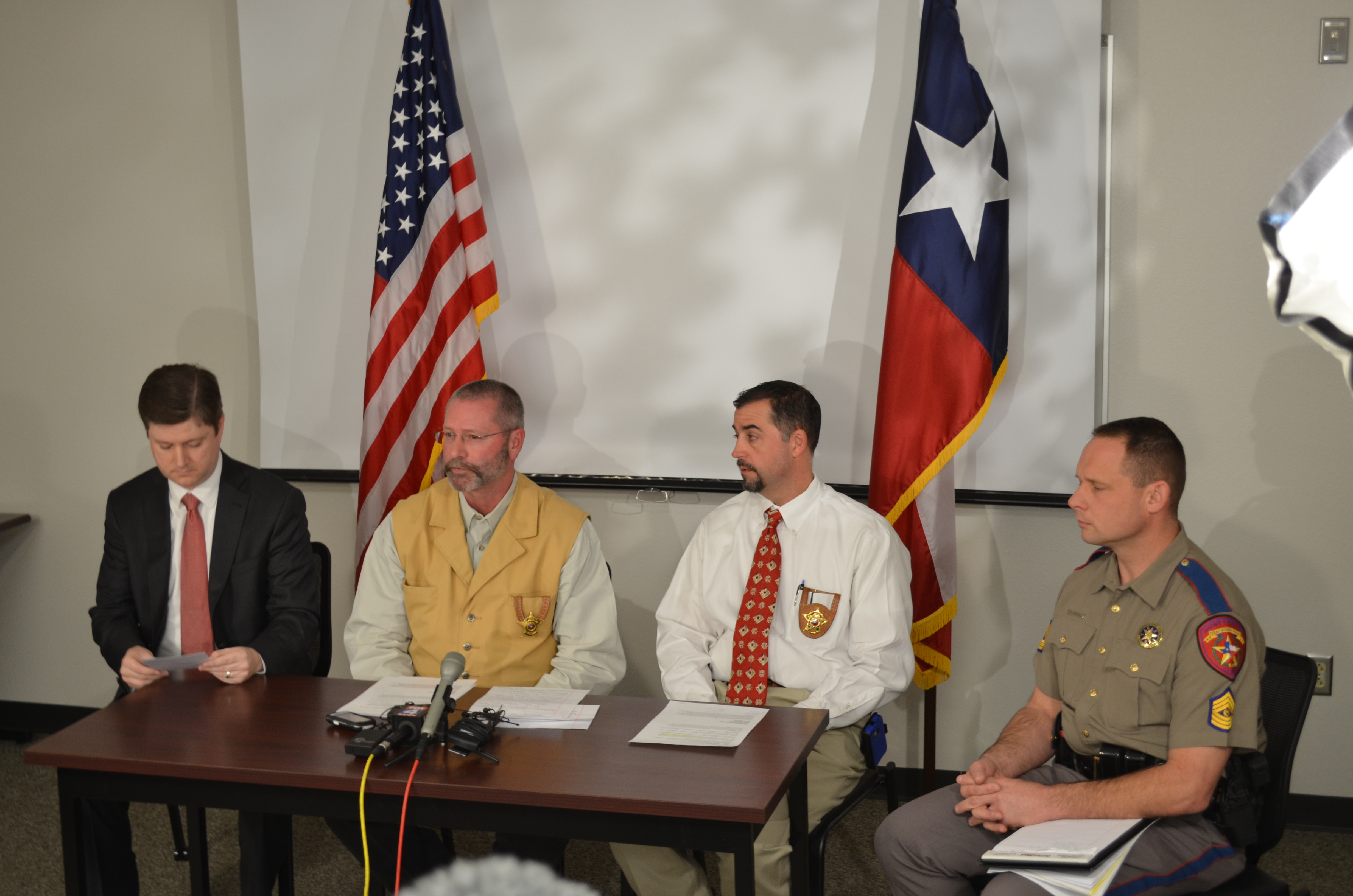 Erath County Sheriff's Office holds a press conference discussing the murders of Chris Kyle, 38, and Chad Littlefield, 35. At the desk are (from left) Erath Co. District Attorney Alan Nash, Sheriff Tommy Bryant, Captain Jason Upshaw, State Trooper Lonny Haschel. (Landon Haston, Texan News Service)