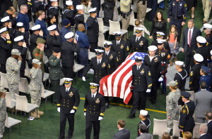 Slain Navy SEAL Chris Kyle's casket is removed from the stadium following his memorial service. (Landon Haston, Texan News Service)