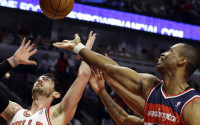 In this April 17, 2013 file photo, Washington Wizards center Jason Collins, right, battles for a rebound against Chicago Bulls guard Kirk Hinrich during the first half of an NBA basketball game in Chicago. Jason Collins has become the first male professional athlete in the major four American sports leagues to come out as gay. Collins wrote a first-person account posted Monday on Sports Illustrated&#039;s website. The 34-year-old Collins has played for six NBA teams in 12 seasons. He finished this past season with the Washington Wizards and is now a free agent. He says he wants to continue playing. 