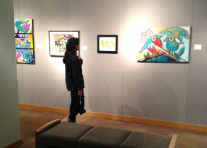 Tarleton student, Stefanie Musick, looking at one of the many paintings in the gallery.   (Drew Isom, Texan News Service)