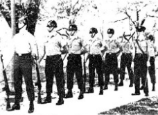The Wainwright Rifles stand at parade rest during a 1986 performance. (1986 File Photo by Mary Ann Foreman, The J-TAC)