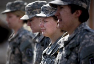 Private Sarah Oliver stands at attention and listens to instruction during a marching formation training session March 23, 2013 at the Army National Guard Armory in Casper, Wyo. Private Oliver was the first woman to sign up to serve in the Artillery with the Wyoming National Guard since the ban on women in combat was lifted last year.  (AP Photo/Casper Star-Tribune, Leah Millis)