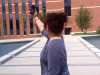 A Tarleton student searches for a Wi-Fi signal outside of the Nursing Building.