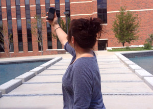 A Tarleton student searches for a Wi-Fi signal outside of the Nursing Building. (Photo Illustration by Shelby White and Carissa Gentry)