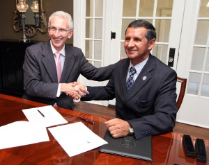 Tarleton President Dominic Dottavio and Jorge Humberto Bolaños, vice president of Universidad Politécnica Estatal del Carchi, sign an agreement for collaboration between the universities Sept. 25 at the Trogdon House. (Photo courtesy of Tarleton State University)