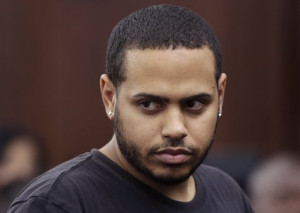 Christopher Cruz appears in criminal court in New York, Wednesday, Oct. 2, 2013. Cruz, 28, of New Jersey, was charged Wednesday with reckless driving after prosecutors said he touched off a tense encounter with the driver of a sport utility vehicle and a throng of other bikers that ended with blood and broken bones on a Manhattan street. He was also charged with unlawful imprisonment. His bail was set at $1,500 cash. (AP Photo/Seth Wenig)