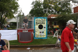 "The ""Crazy Water Dunking Booth"" is one of many attractions at the Crazy Water Festival. (Landon Haston, Texan News Service)"