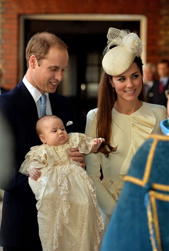 Britain's Prince William, Kate Duchess of Cambridge with their son Prince George arrive at Chapel Royal in St James's Palace in London, for the christening of the three month-old Prince George, Wednesday Oct. 23, 2013.  (AP Photo/John Stillwell/Pool)