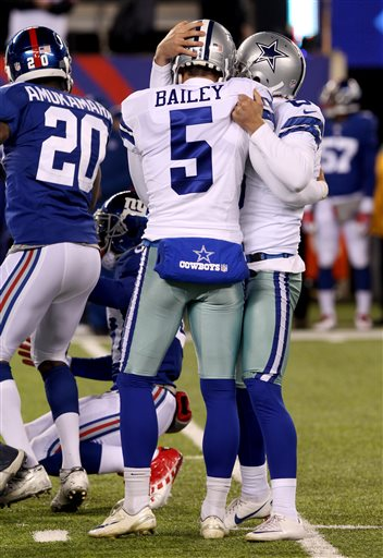 Dallas Cowboys kicker Dan Bailey (5) is congratulated by Chris Jones, right, after kicking a game-winning field goal against the New York Giants during the second half of an NFL football game, Sunday, Nov. 24, 2013, in East Rutherford, N.J. The Cowboys won 24-21.  (AP Photo/Peter Morgan)