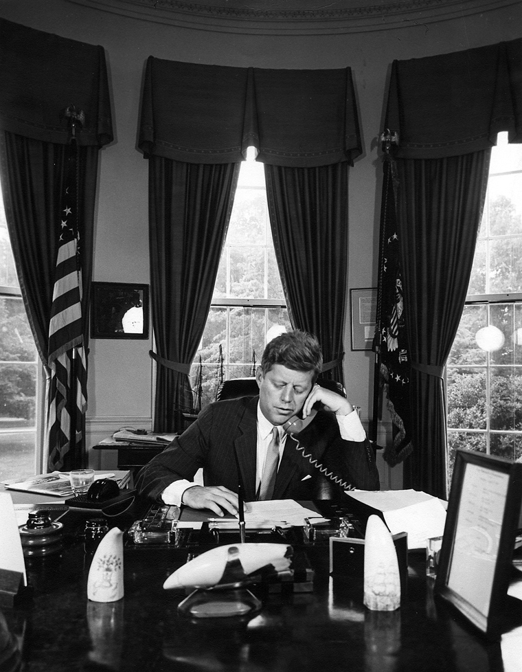 President Kennedy addresses the AMVETS convention on Aug. 23, 1962, in New York City by  telephone.  (Abbie Rowe, National Park Service, John F. Kennedy Presidential Library and Museum, Boston)