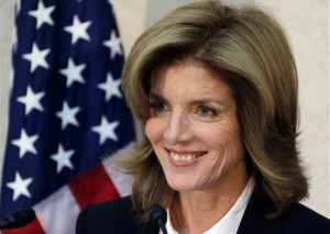 In this Nov. 15, 2013 file photo, new U.S. Ambassador to Japan Caroline Kennedy smiles as she gives a statement upon her arrival in Japan at the Narita International Airport in Narita, east of Tokyo.  The daughter of President John F. Kennedy says his spirit lives on even though his life was cut short.  Caroline Kennedy said in an interview with Japan's Yomiuri newspaper that she often meets people who tell her they were inspired by her father. She said it's a reminder that we all have a duty to work together for a better world.  (AP Photo/Koji Sasahara, Pool, File)