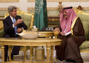 U.S. Secretary of State John Kerry, left, talks with Saudi Foreign Minister Prince Saud Al-Faisal bin Abdulaziz al-Saud, after Kerry arrived in Riyadh, Saudi Arabia, Sunday, Nov. 3, 2013.  (AP Photo / Jason Reed, Pool)