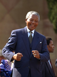 In this May 10, 1994, file photo, Nelson Mandela dances at a celebration concert in Pretoria, South Africa, following his inauguration as the country's first black president. South Africa's president says, Thursday, Dec. 5, 2013, that Mandela has died. He was 95.  (AP Photo/John Parkin, File)