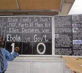 Social Commentator Alfred Sirleaf, gives comment on current events in Liberia including the deadly Ebola virus by speaking and writhing them down on a blackboard in Monrovia, Liberia, Thursday, July 31, 2014. The worst recorded Ebola outbreak in history surpassed 700 deaths in West Africa as the World Health Organization on Thursday announced dozens of new fatalities. (AP Photo/Jonathan Paye-Layleh)