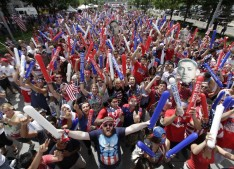 United States fans cheer while watching before the start of the 2014 World Cup soccer match between the United States and Belgium at a public viewing party, in Detroit, Tuesday, July 1, 2014. (AP Photo/Paul Sancya)