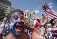 USA team soccer fan David Dunlap from Chesapeake City, Md., sings the Star Spangle Banner as he and a crowd watch live on a monitor the USA vs Belgium World Cup soccer match in Washington, Tuesday, July 1, 2014. (AP Photo/Manuel Balce Ceneta)