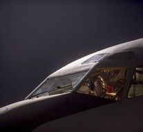 In this Tuesday, Sept. 23, 2014, photo, released by the U.S. Air Force, Maj. Gena Fedoruk, a KC-135 Stratotanker pilot with the 340th Expeditionary Air Refueling Squadron, pre-flights her aircraft before taking off from a base in the U.S. Central Command area of responsibility in support of a mission conducting airstrikes in Syria. U.S.-led coalition warplanes bombed oil installations and other facilities in territory controlled by Islamic State militants in eastern Syria on Friday, Sept. 26, 2014, taking aim for a second consecutive day at a key source of financing that has swelled the extremist group's coffers, activists said. (AP Photo/U.S. Air Force, Matthew Bruch)