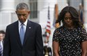 President Barack Obama and first lady Michelle Obama stand on the South Lawn of the White House in Washington, Thursday, Sept. 11, 2014, as they observe a moment of silence to mark the 13th anniversary of the 9/11 attacks. (AP Photo/Charles Dharapak)