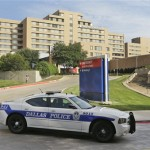 FILE- In this Sept. 30, 2014, file photo, a police car drives past the entrance to the Texas Health Presbyterian Hospital in Dallas. Hospitals around the country are already getting ample opportunities to test their infection control procedures due to a growing number of Ebola Virus infection false alarms. (AP Photo/LM Otero, File)