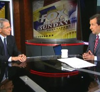"""In this frame grab provided by Fox News, Dr. Anthony Fauci, director of The National Institute of Allergy and Infectious Diseases, left, is interviewed in Washington, D.C., on """"FOX News Sunday"""" by host Chris Wallace, Sunday Oct. 26, 2014. The gulf between politicians and scientists over Ebola widened as Fauci made the rounds on five major Sunday morning talk shows to warn that the mandatory, 21-day quarantining of medical workers returning from West Africa is unnecessary and could discourage volunteers from traveling to the danger zone. He said that close monitoring of medical workers for symptoms is sufficient, and warned that forcibly separating them from others, or quarantining them, for three weeks could cripple the fight against the outbreak in West Africa — an argument that humanitarian medical organizations have also made. (AP Photo/Fox News)"""