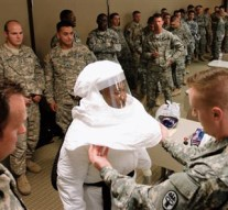 Spec. Lance Langenberg, right, checked 1st Sgt. Christopher Bell's protective suit during a training session Tuesday at Fort Bliss. Bell and other soldiers in the 2nd Battalion, 501st Aviation Regiment are training on how to protect themselves from Ebola in anticipation of a mission to Africa. Langenberg is one of several trainers for the exercise.