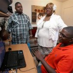 Parents of Autistic Children-Relief founder Linda Davis, center, and her two sons, Devin, left, and Darius, right, watch a video in their Hewitt home. Davis applied for nonprofit status for her organization so she can begin accepting donations to expand the services.