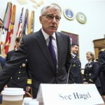 Defense Secretary Chuck Hagel, left, and Joint Chiefs Chairman Gen. Martin Dempsey, right, arrive on Capitol Hill in Washington, Thursday, Nov. 13, 2014, to testify before the House Armed Services committee hearing on the Islamic State group. (AP Photo/Evan Vucci)