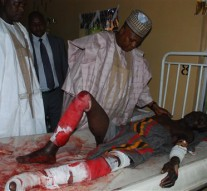 Borno state governor Kashim Shettima, speaks to a victim of suicide bomb attack receiving treatment at a specialist hospital in Maiduguri, Nigeria, Tuesday, Nov. 25, 2014. Two female suicide bombers blew themselves up Tuesday in a crowded market in Nigeria's northeastern city of Maiduguri, killing at least 30 people, according to witnesses and a security official. Boko Haram, Nigeria's Islamic extremist rebels, are suspected of the bombings, as they have carried out many similar attacks. The bombings highlight Nigeria's ongoing insecurity in which 1,500 people have been killed by the militant's insurgency this year, according to Amnesty International. (AP Photo/Jossy Ola )