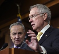 Senate Chales Schumer, D-N.Y. listens at left as Senate Majority Leader Harry Reid of Nev. speaks during a news conference on immigration reform, Thursday,Nov. 20, 2014, on Capitol Hill in Washington. (AP Photo/Susan Walsh)