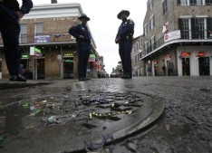 FILE - In this Feb. 10, 2013 file photo, Louisiana State Police stand near the 400 block of Bourbon Street in the French Quarter in New Orleans. A spike in violent crime in the French Quarter is unsettling residents and comes just as New Orleans prepares to host crowds of tourists for Mardi Gras. (AP Photo/Gerald Herbert, File)