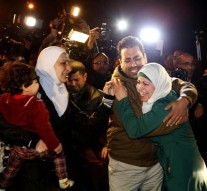 A man comforts the wife of Jordanian pilot, Lt. Muath al-Kaseasbeh, who is held by the Islamic State group militants, during a protest in front of the Royal Palace in Amman, Jordan, Wednesday, Jan. 28, 2015. Jordan on Wednesday offered a precedent-setting prisoner swap to the Islamic State group in a desperate attempt to save a Jordanian air force pilot the militants purportedly threatened to kill, along with a Japanese hostage. (AP Photo/Raad Adayleh)
