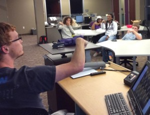 Members watch as Cory Crow goes more into detail about the possibilities ASL can offer.  Photo courtesy of the TSU ASL Facebook page.