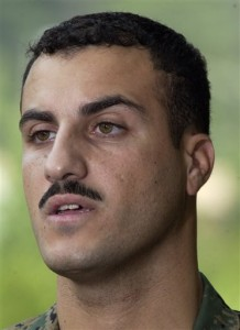 FILE - In this July 19, 2004 file photo, Marine Cpl. Wassef Ali Hassoun makes a statement to the press outside Quantico Marine Base in Quantico, Va. Hassoun's trial on desertion accusations starts Monday, Feb. 9, 2015 at Camp Lejeune, N.C.(AP Photo/Steve Helber, File)