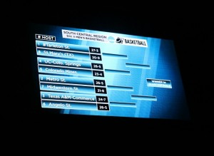 South Central Regional match-ups, displayed on the video board in Wisdom Gym. Photo by Travis M. Smith