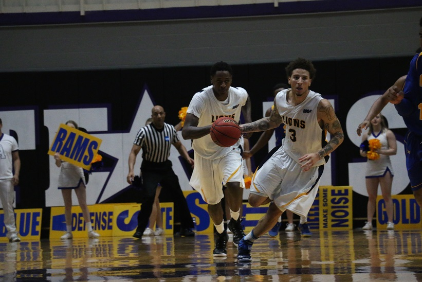 LaDon Carnegie brings the ball up the court before fouling out. Photo by Cameron Cook