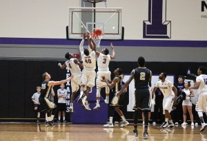The Texans outrebounded UCCS by ten because of hustle like this. Five white jerseys to three navy. Photo by Cameron Cook
