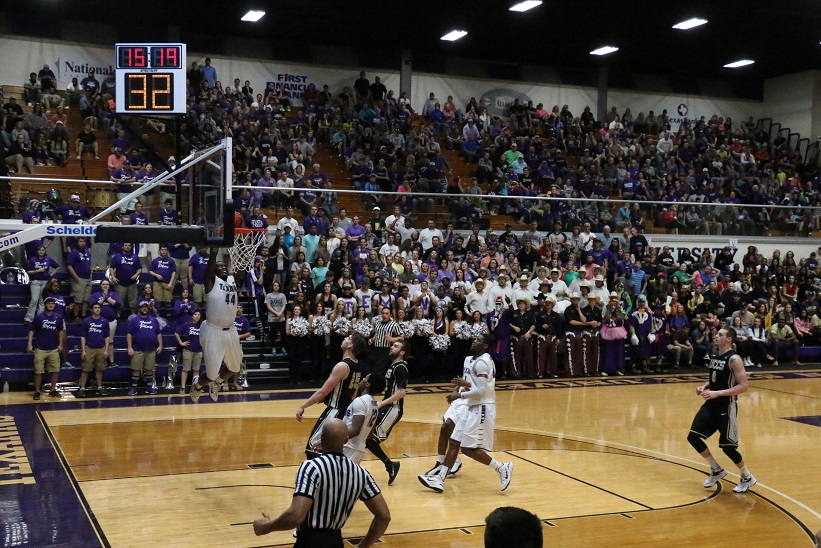 Clemons throwing down an impressive alley-oop in front of a capacity Wisdom Gym crowd. Photo by Cameron Cook