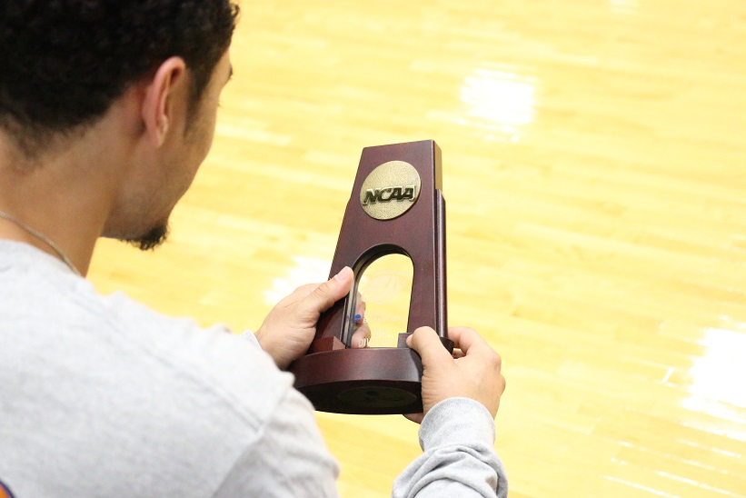 Hardge admiring his Regional Championship trophy and reflecting on the 2014-15 season. Photo by Travis M. Smith