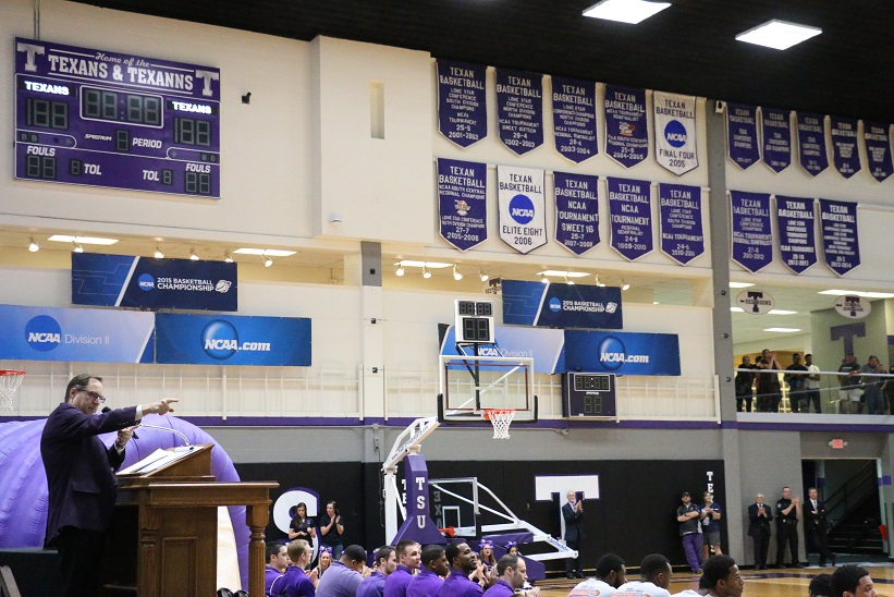 Reisman addressing the crowd during the celebration. There will soon be a third white banner hanging in the Wisdom Gym rafters. Photo by Travis M. Smith/TNS