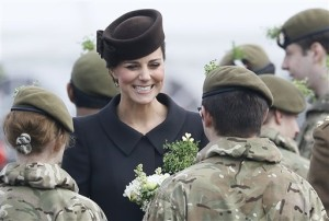 Britain's Kate, the Duchess of Cambridge meets cadets during a visit to the 1st Battalion Irish Guards at the St. Patrick's Day Parade at Mons Barracks, Aldershot, in England, Tuesday, March 17, 2015. The Duke of Cambridge attended the Parade as Colonel of the Regiment. The Duchess of Cambridge presented the traditional sprigs of shamrocks to the Officers and Guardsmen of the Regiment. (AP Photo/Kirsty Wigglesworth)