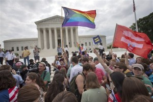 The crowd reacts as the ruling on same-sex marriage was announced outside of the Supreme Court in Washington, Friday June 26, 2015. The Supreme Court declared Friday that same-sex couples have a right to marry anywhere in the US.  (AP Photo/Jacquelyn Martin)