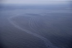 FILE - This March 31, 2015, aerial file photo, shows an oil sheen drifting from the site of the former Taylor Energy oil rig in the Gulf of Mexico, off the coast of Louisiana.  Capitol Hill lawmakers from Louisiana have intervened on behalf of Taylor Energy Company that has failed to stop a decade-old oil leak in the Gulf of Mexico but lobbied for a refund of money reserved for spill containment work, according to letters obtained by The Associated Press through public records requests.(AP Photo/Gerald Herbert, File)