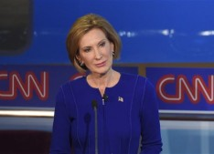 Republican presidential candidate, businesswoman Carly Fiorina stands during the CNN Republican presidential debate at the Ronald Reagan Presidential Library and Museum on Wednesday, Sept. 16, 2015, in Simi Valley, Calif.  (AP Photo/Mark J. Terrill)