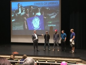 "Pictured is Dr. Robert Anderson (far left) recognizing the students who helped edit ""Streets  of Urbino"" before the film was played at the showing.(Photo by Sydney Burns, Texan News)"