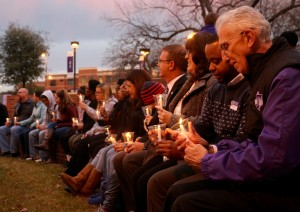 Participants in the amphitheater are listening to the first speaker give an MLK quote. (Photo by Sydney Burns, Texan News)