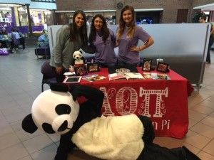 AOII sisters Katy Seiferman, Priscilla Fregoso and Abriawna Moon set up a booth for potential members to visit in the Thompson Student Center. Also at the booth was their mascot, the panda.(Photo by Ashley Ford, Texan News)