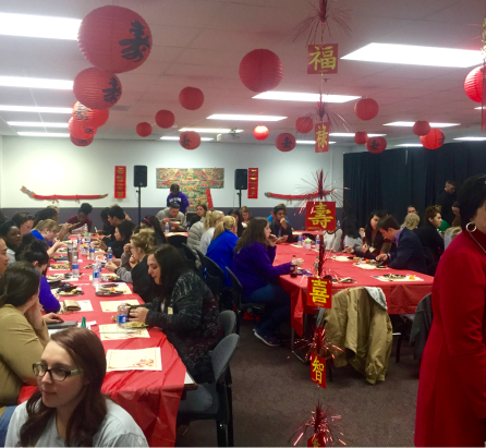 Red accents were hung all over the room to symbolize the tradition of bringing good luck during the Chinese New Year celebration.(Photo by Sammie Wight, Texan News)
